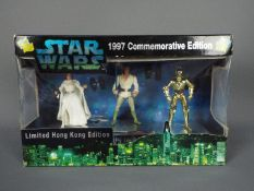 Star Wars, Kenner - A rare boxed Kenner 1997 Commemorative Edition 3/4 action figure set.
