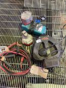 2 battery chargers with batteries and a set of jump leads