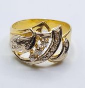 18ct gold ring with inset diamonds and diamond trilogy centre. weight 5.4g and size S