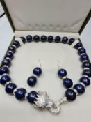 A large beaded lapis lazuli necklace and earrings set in presentation box.The white metal (untested)