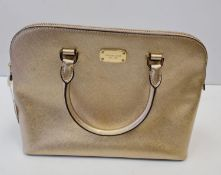 Michael Kors new and unused handbag in a subtle shade of Chantilly gold