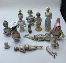 A Quantity of Bisque Half Dolls.