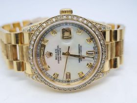 18ct Rolex Day-Date 36mm Costumed Diamond Shoulders and Bezel. 1987 Model. Come with box, no paper.