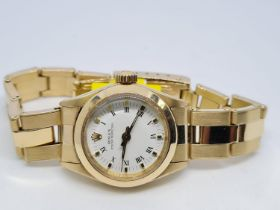 Rolex 14ct All Gold Ladies Watch Factory Dial White. 1980 Model. 26mm diameter. Come with box, no