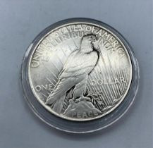 Silver Liberty PEACE DOLLAR 1927. Having the rarer mint mark of Denver. Fine/Extra fine with