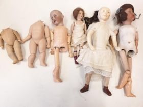 A Collection of Antique Jointed Dolls.