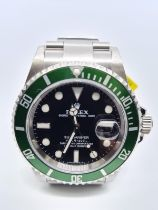 Rolex Submariner Gents Watch with Green Bezel and Black Face. 40mm diameter. This is the