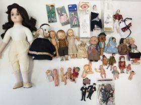 A Large Quantity of Small Vintage Dolls Inc: Porcelain, Plastic, Etc.
