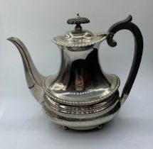 A Regency style silver tea pot with a London 1904 Hallmark good overall condition, weight 704g and