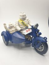 A rare and real collector?s item, French, cast iron MICHELIN MAN and his son on a combination