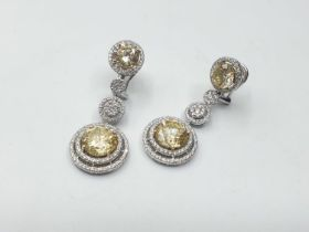 18ct White Gold pair of Earrings with 260 Round Brilliant cut diamond. Total Diamond Content (3.