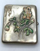RUSSIAN SILVER CIGARETTE CASE WITH ENAMEL FLORAL MOTIF FROM LATE 19TH CENTURY WITH SAPPHIRE