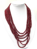 An impressive seven row multi-faceted ruby necklace, Length 44-60cm Weight: 106 g. Rubies are colour