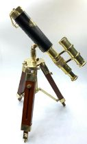 A highly ornamental, modern, brass, replica of an Edwardian telescope, on a mahogany and brass