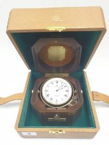 Baume and Mercier, lockable with key Geneve gimballed travelling CLOCK, in walnut case, Quartz