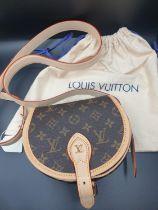 Louis Vuitton Shoulder BAG, as new in Half Drum shape. 15 x 18 cm
