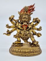 A very early Oriental gilt on bronze statue of a fertility god, weight 2.25kg and 19cm tall approx