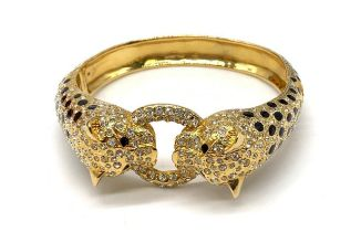 A large silver (stamped 925) and gold plated bracelet in the Cartier style Weight: 82g. In a