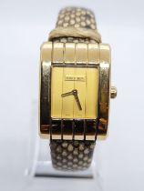 18ct gold ladies Boucheron watch, tank style with gold face and original Boucheron snake skin