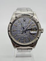 Rolex Oyster Perpetual Date 1965 with rare dials, 36mm case and steel strap, comes with original