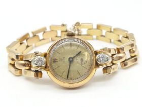 18ct gold Tudor vintage ladies watch, diamonds on each side of face, comes with safety chain and