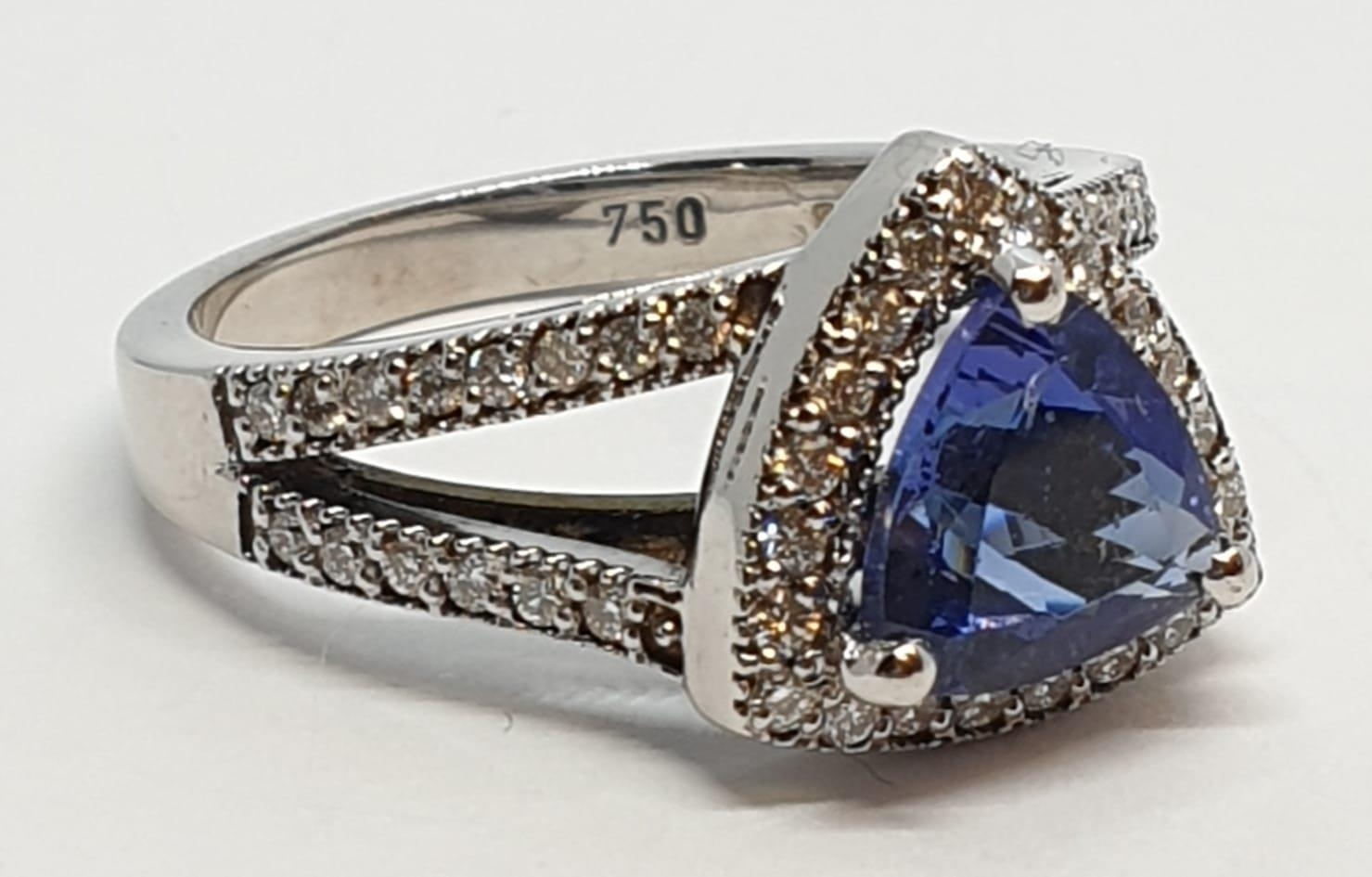 18CT WHITE GOLD RING WITH TRIANGULAR TANZANITE CENTRE AND DIAMONDS ON SHOULDERS, WEIGHT 7G AND - Image 2 of 10