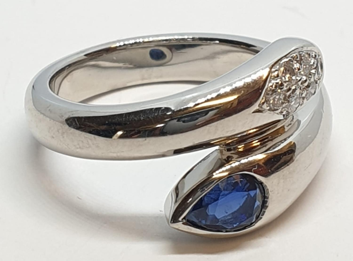 Platinum cross over ring with 0.60ct Thai sapphire and 0.30ct encrusted diamonds, weight 13.7g and - Image 9 of 10