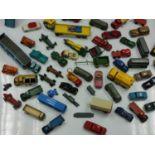 45 Miscellaneous vintage Dinky, Corgi and Budgie toys, plus three vintage catalogues.