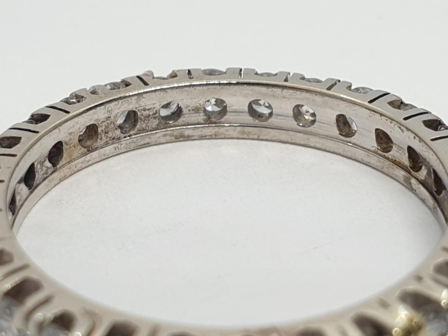 Diamond full eternity ring (tested 18ct gold), weight 2.27g and size J - Image 3 of 3