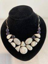 Silver stone set necklace. Having polished howlite stones to front with lengthy 55cm silver chain to