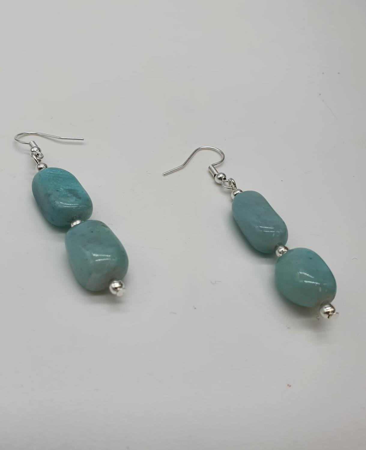 A larimar necklace, bracelet and earrings set in a presentation box. Total weight: 228g./ LARIMAR is - Image 4 of 5