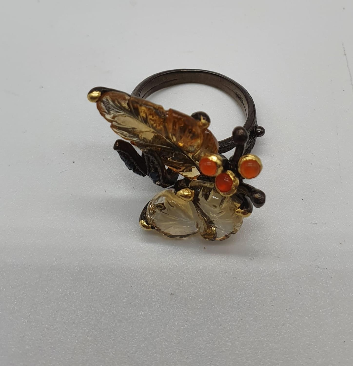 A unique Edwardian silver (unmarked) ring with carved semiprecious and precious stones (citrine, - Image 4 of 5