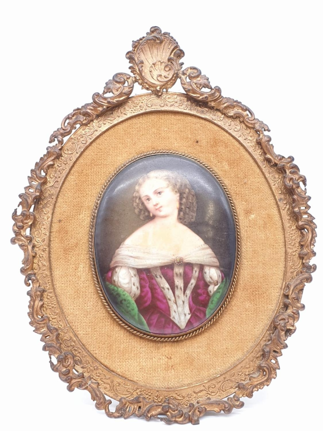 An 18th century porcelain miniature of an Ermine wearing lady in ornate frame, 8x6cm