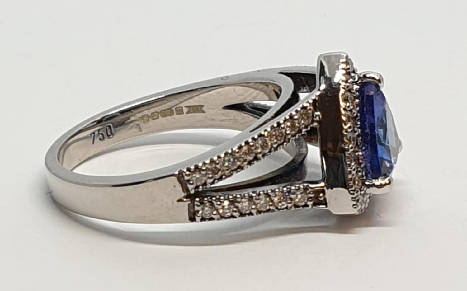 18CT WHITE GOLD RING WITH TRIANGULAR TANZANITE CENTRE AND DIAMONDS ON SHOULDERS, WEIGHT 7G AND - Image 7 of 10