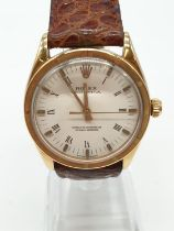 Vintage 18ct Rolex oyster perpetual gents watch with gold case and leather strap, automatic and 36mm