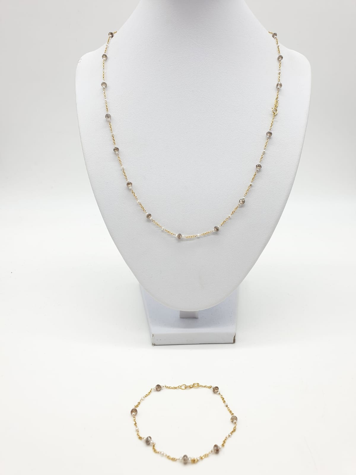 14ct gold brown diamond and pearl necklace with matching bracelet, total weight 5.6g and over 9ct