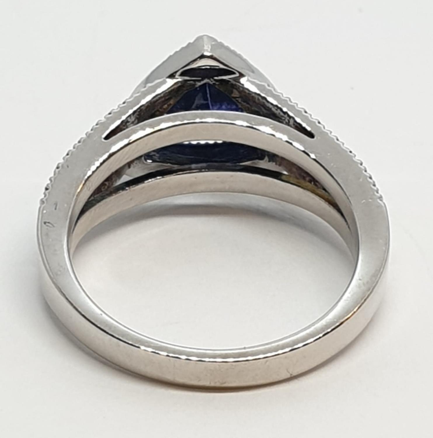 18CT WHITE GOLD RING WITH TRIANGULAR TANZANITE CENTRE AND DIAMONDS ON SHOULDERS, WEIGHT 7G AND - Image 4 of 10