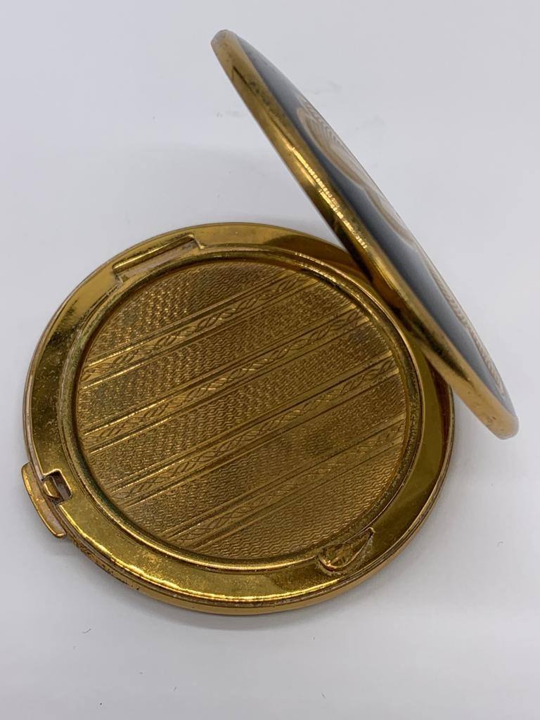 Vintage 1950/60's compact by Melissa. Black enamel lid with gold feature engine turned base. - Image 2 of 4
