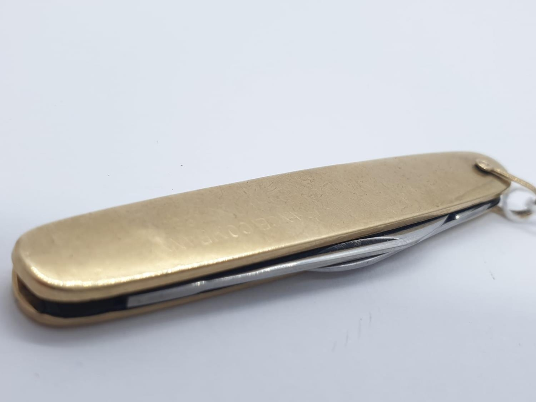 10ct gold pen knife, weight 21.4g