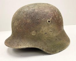 WW2 German M35 Helmet and liner with Normandy textured camouflage finish.