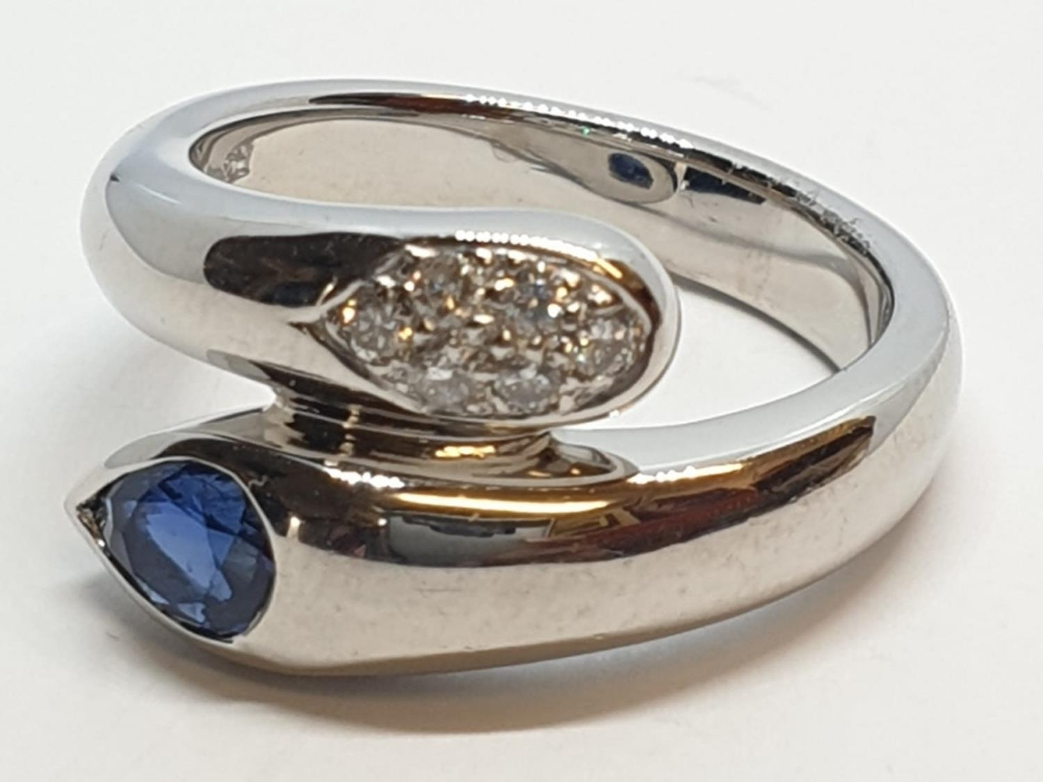 Platinum cross over ring with 0.60ct Thai sapphire and 0.30ct encrusted diamonds, weight 13.7g and - Image 2 of 10