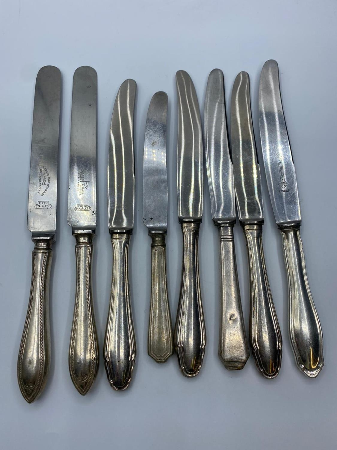 Assortment of 8x silver handled knives (8)