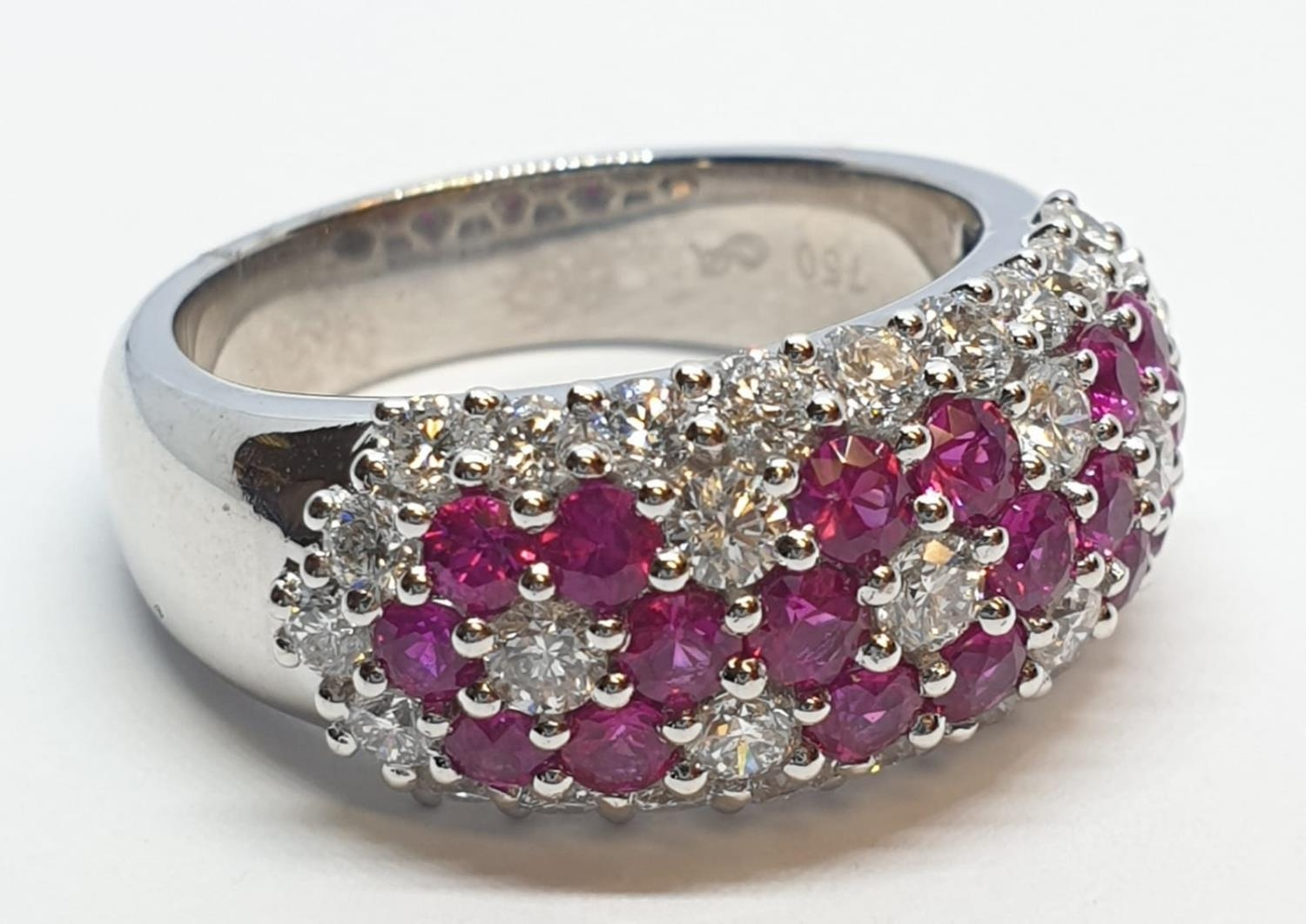 18ct white gold ring with over 1ct ruby and 1.8ct diamonds in flower design, weight 9.39g and size M
