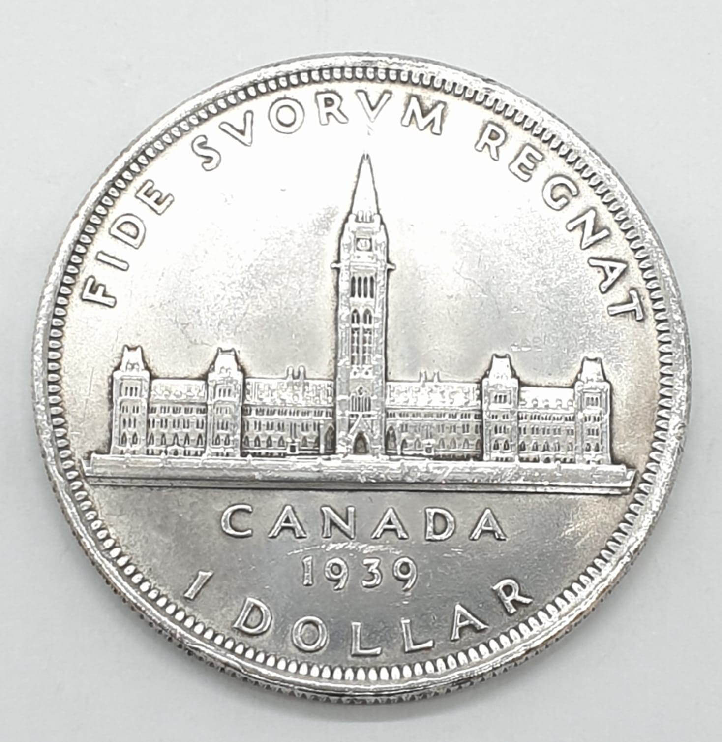 Silver 1939 Canadian 'Ottawa' dollar. Clear and raised definition to both sides. Slight nicks to