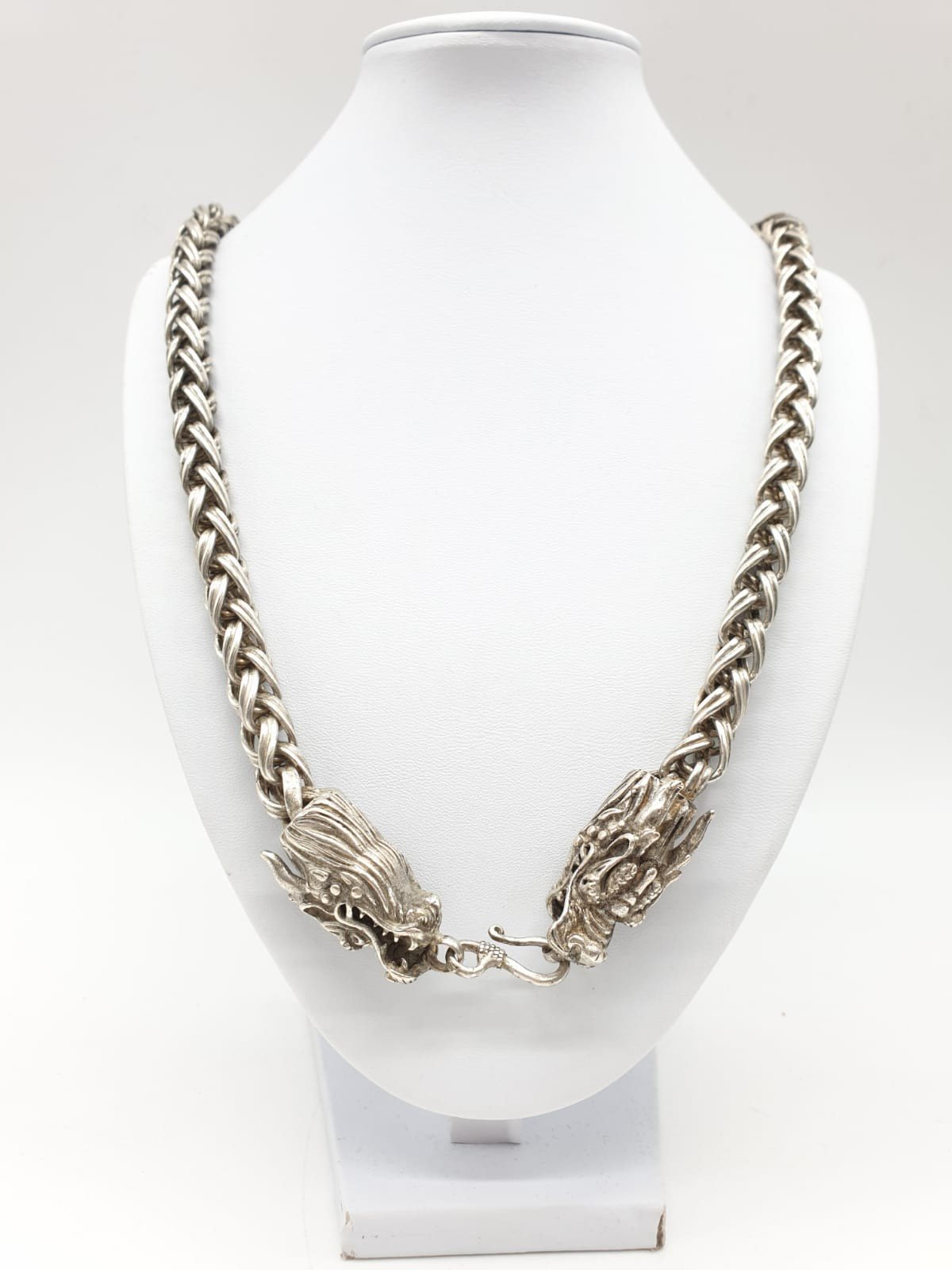 A Tibetan silver, braded chain, necklace with two Chinese dragon heads. Necklace length: 68cm,
