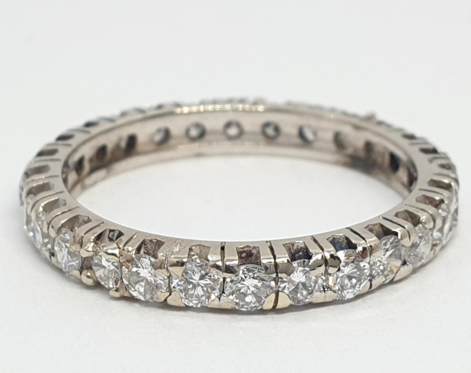 Diamond full eternity ring (tested 18ct gold), weight 2.27g and size J