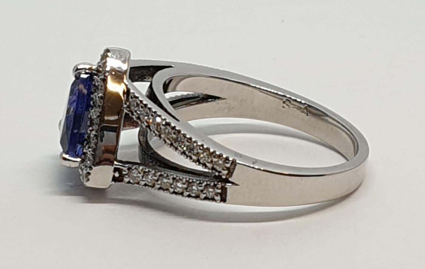 18CT WHITE GOLD RING WITH TRIANGULAR TANZANITE CENTRE AND DIAMONDS ON SHOULDERS, WEIGHT 7G AND - Image 6 of 10