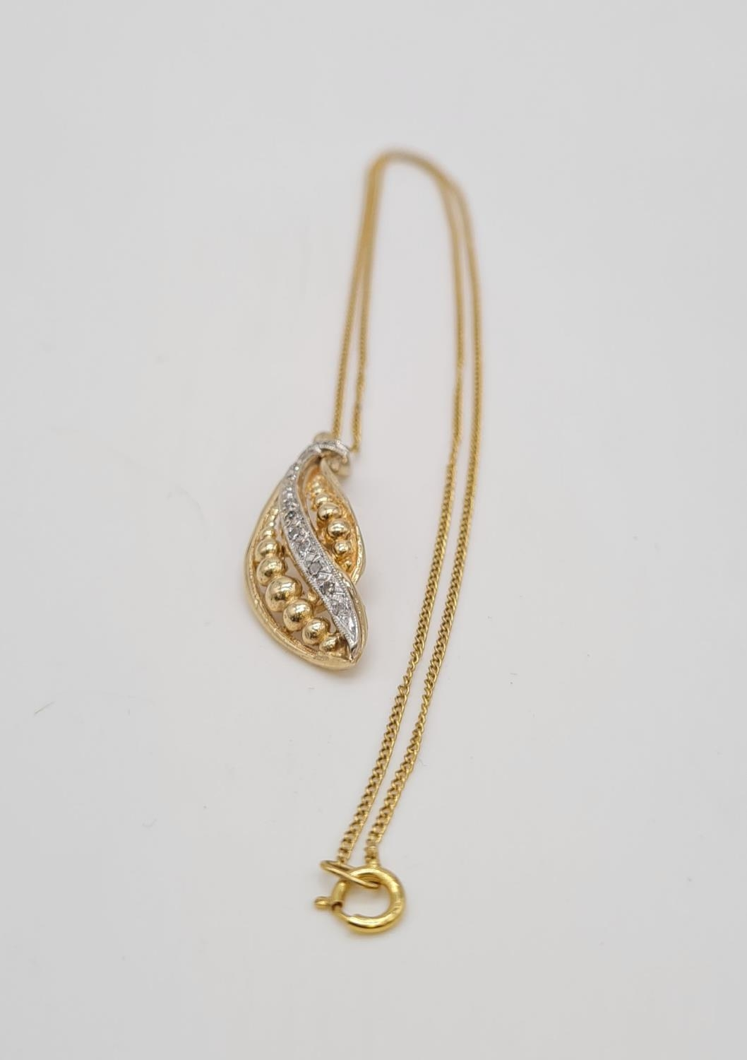 18ct gold diamond set pendant on chain, weight 3.69g and 40cm long, pendant 3 x 1cm - Image 8 of 9
