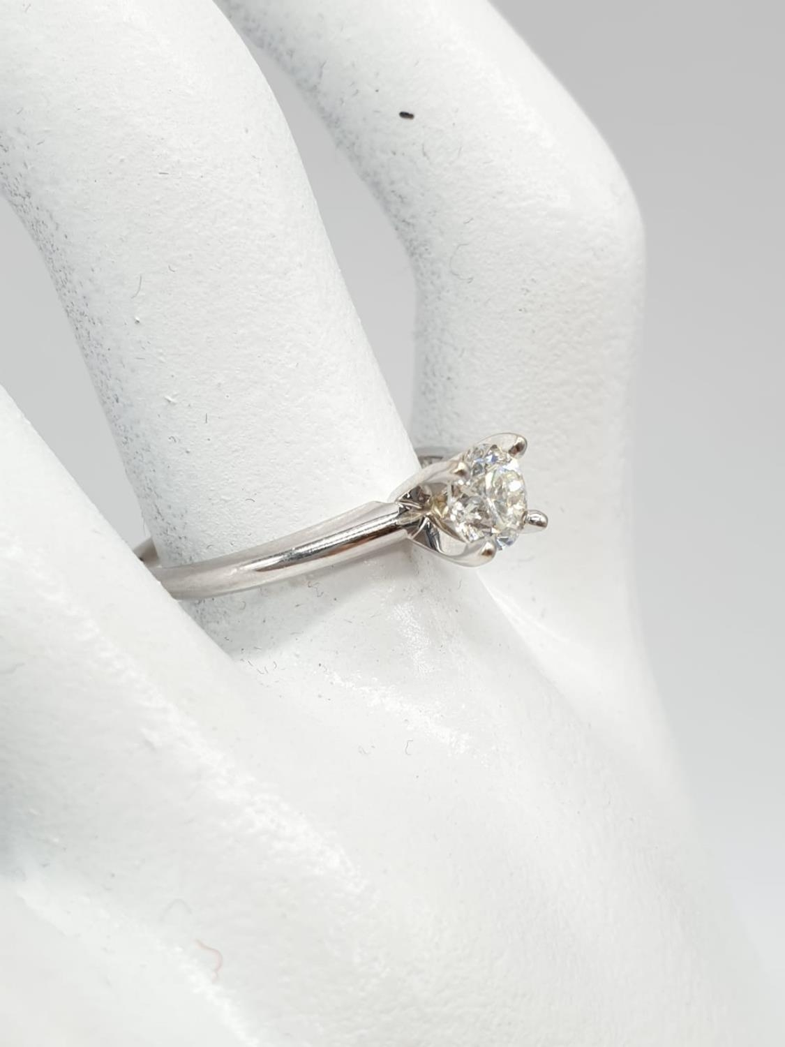 14ct white gold with 0.56ct diamond solitaire ring (round brilliant cut, colour H, clarity SI1 - Image 2 of 18