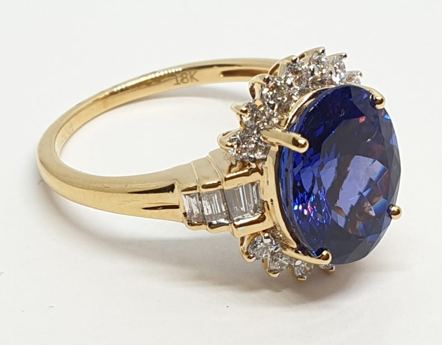 18ct yellow gold ring with 4ct tanzanite centre and further diamonds surrounding and on each - Image 3 of 10